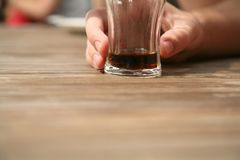 Hand holding glass. With drink Stock Photos