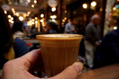 hand holding a glass of coffee stock photography