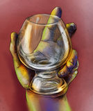 Hand holding a glass royalty free stock photo