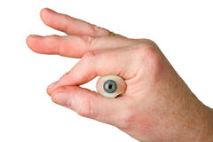 Hand holding glass eye Royalty Free Stock Photography