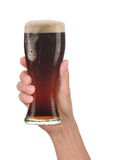 Hand Holding Glass of Foamy Beer Stock Photo