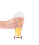 Hand holding glass full of beer. Stock Photography