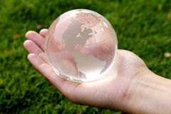 Hand holding a glass globe Stock Images