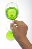 Hand holding glass of green fluid Royalty Free Stock Image