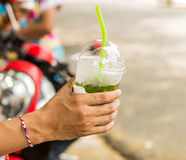 Hand holding. A glass of green tea Royalty Free Stock Photos