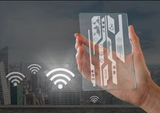 Hand holding glass interface wifi. Digital composite of Hand holding glass interface wifi Stock Photography