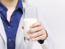 Hand holding a glass of milk Stock Photo