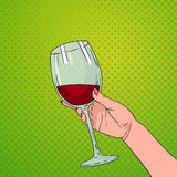Hand Holding Glass Of Red Wine Pop Art Retro Pin Up Background. Vector Illustration Stock Photos
