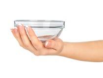 Hand holding a glass salad bowl Stock Photos