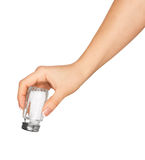 Hand holding a glass saltcellar with salt stock images