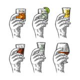 Hand holding glass with tequila, vodka, rum, cognac, whiskey, gin. Royalty Free Stock Images