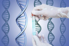 Hand holding glass tube with blue liquid inside, and DNA background Stock Image