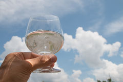 Hand holding glass of water Stock Image