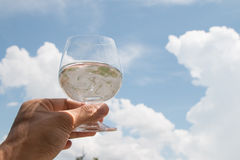 Hand holding glass of water Stock Images
