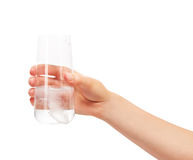 Hand holding glass with white effervescent tablet in water Stock Photography