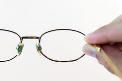 Hand holding glasses Royalty Free Stock Image