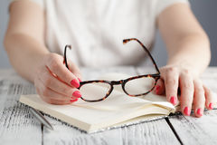 Hand holding glasses Stock Photography