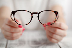 Hand holding glasses Stock Image