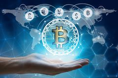 Hand holding global network using Currencies sign symbol interface of Bitcoin Fintech, virtual currency blockchain technology con. Cept, Investment Financial royalty free stock photo