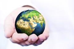 Hand holding the globe Royalty Free Stock Photo