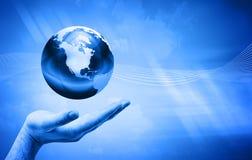 Hand holding the globe Stock Image