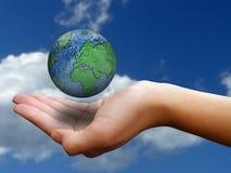 Hand holding globe Royalty Free Stock Image