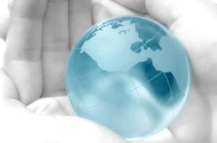 Hand holding globe Stock Photography