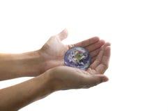 Hand holding globe stock images
