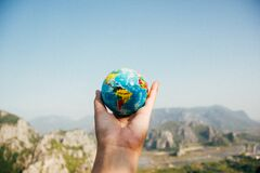 Hand holding globe Royalty Free Stock Images