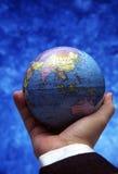 Hand holding globe (Asia region) stock photos