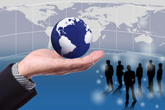 Hand holding globe with business people Royalty Free Stock Photo