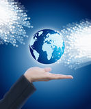 Hand holding globe and fiber optics. Hand holding globe with fiber optics Stock Photography