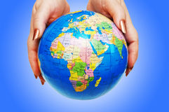 Hand holding globe on the  gradient Stock Photography