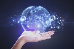 Hand holding globe. Hand holding abstract glowing globe interface. International business concept. 3D Rendering Stock Images