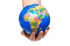 Hand holding globe isolated Royalty Free Stock Image