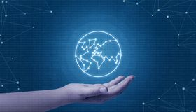 Hand holding globe network concept. Binary code in background and network threads.  royalty free stock photography