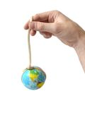 hand holding the globe on a rope Royalty Free Stock Photo