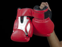 Hand holding gloves Royalty Free Stock Photos