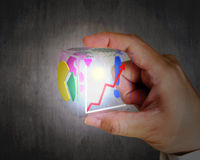 Hand holding glowing colorful transparent glass cubic Royalty Free Stock Photo