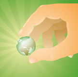 Hand Holding Glowing Earth  Stock Image