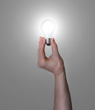 Hand Holding Glowing Light Bulb Royalty Free Stock Photo