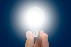 Hand Holding Glowing Light Bulb Royalty Free Stock Photography