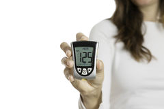 Hand holding a glucometer Royalty Free Stock Photos