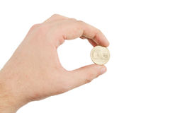 Hand Holding a Gold Coin Isolated on White Stock Images