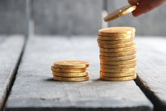 Hand holding gold coins Royalty Free Stock Photography