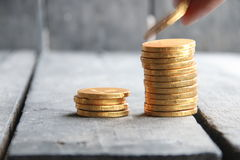 Hand holding gold coins Royalty Free Stock Images