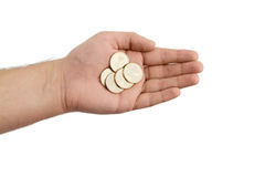 Hand Holding Gold Coins on White. Hand Holding Gold Dollar Coins on a White Background royalty free stock image