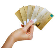 Hand holding a gold credit cards. Isolated on white Royalty Free Stock Photos