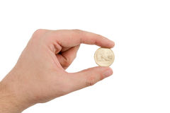 Hand Holding Gold Dollar Coin. On a White Background Stock Photo