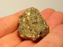 Hand Holding Gold Nugget Stock Images